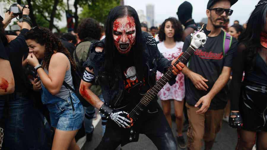 A man takes part in the annual Zombie Walk at Copacabana beach in Rio