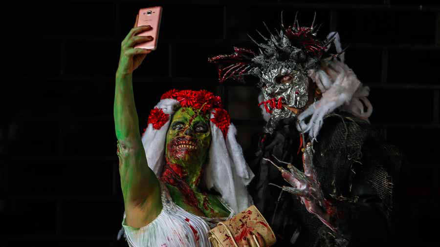 Revellers take part in the annual Zombie Walk in Sao Paulo