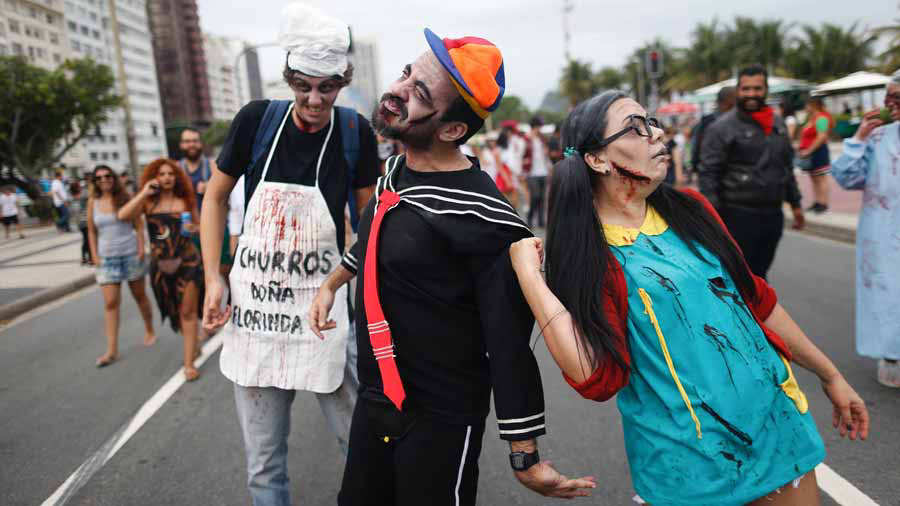 Revellers take part in the annual Zombie Walk at Copacabana beach in