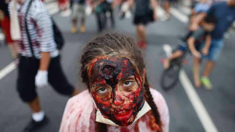 A girl takes part in the annual Zombie Walk at Copacabana beach in Ri