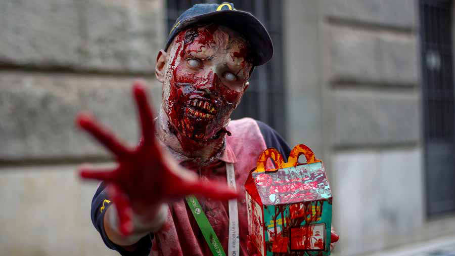 A reveller poses for a picture during the annual Zombie Walk in Sao P