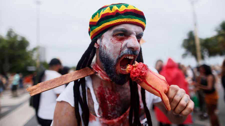 A reveller takes part in the annual Zombie Walk at Copacabana beach i