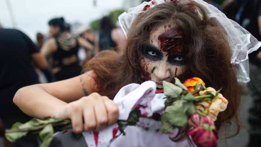A woman takes part in the annual Zombie Walk at Copacabana beach in R