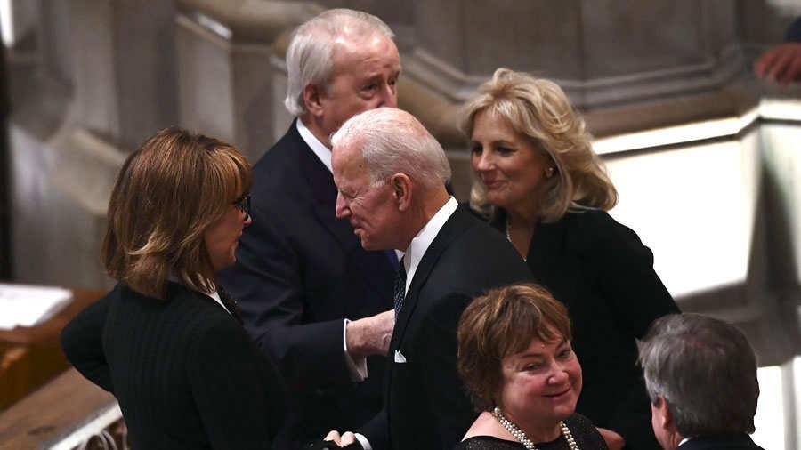 Former US Vice President Joe Biden(C) arrives for the funeral service