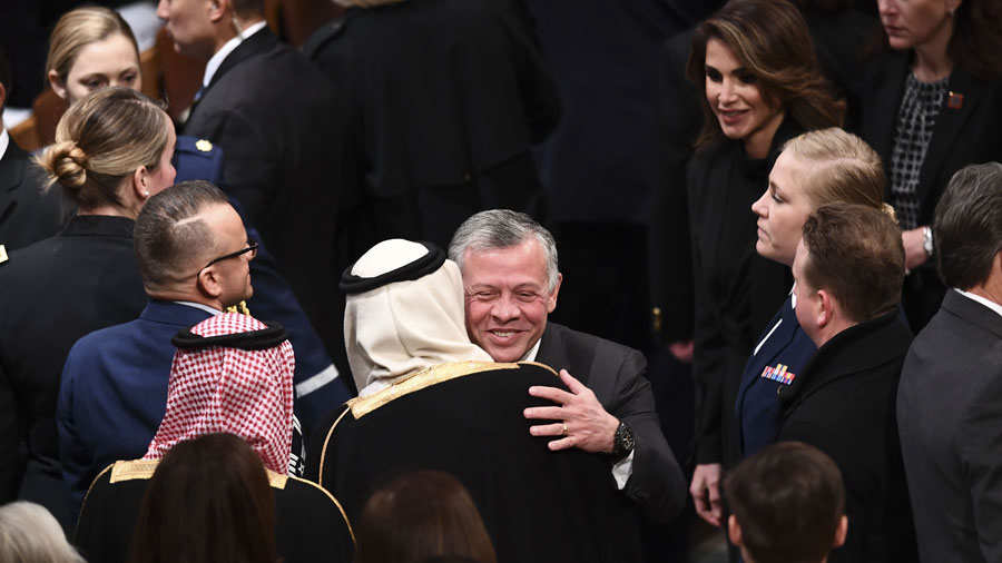 Jordan's King Abdullah II(C)and Queen Rania arrive before the funeral
