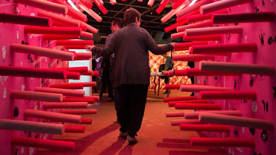A woman walks through a tunnel as she visits the exhibition entitled