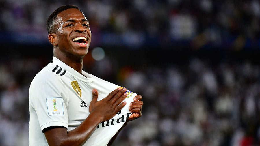 Real Madrid's Brazilian forward Vinicius Junior (L) celebrates an own