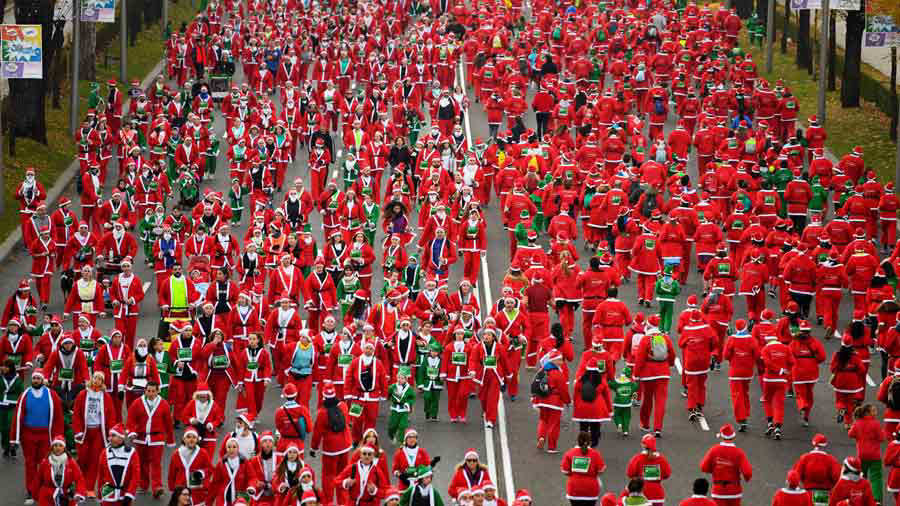 TOPSHOT - People dressed as Santa Claus take part in the Santa Claus