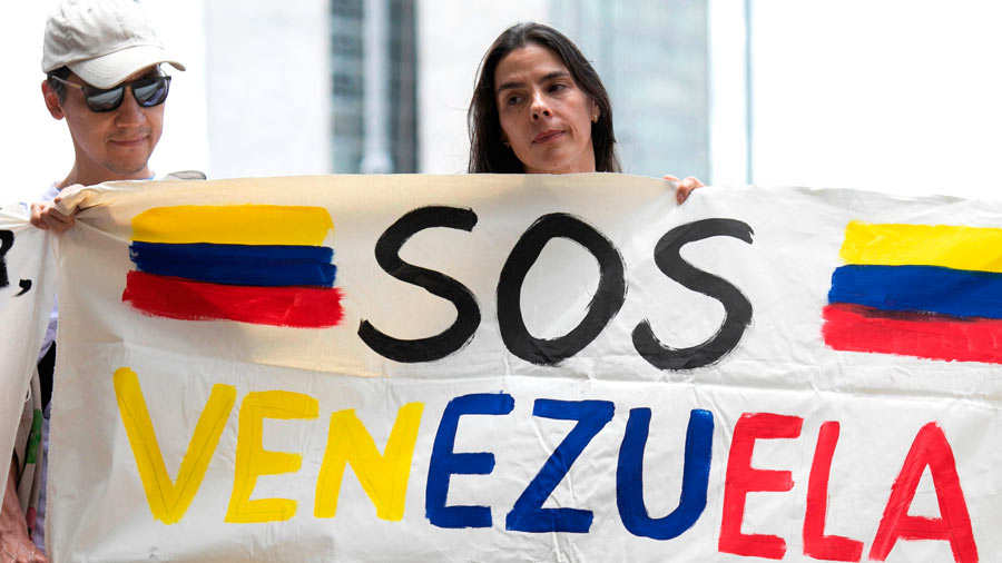 Venezuelans living in Brazil take part in a protest against Venezuela