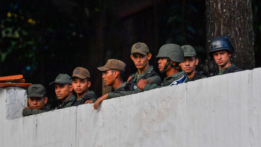 Members of the Bolivarian National Guard remain inside Cotiza Bolivar