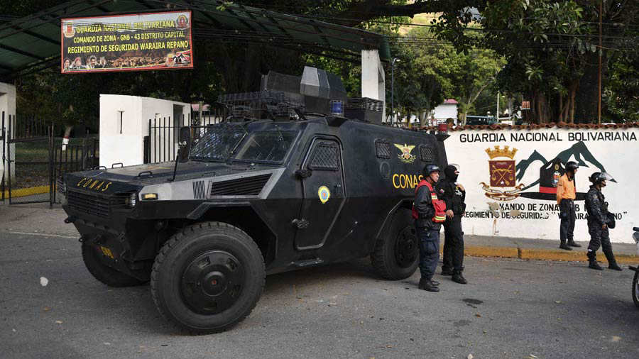 Armoured cars remain in front of Cotiza Bolivarian National Guard hea