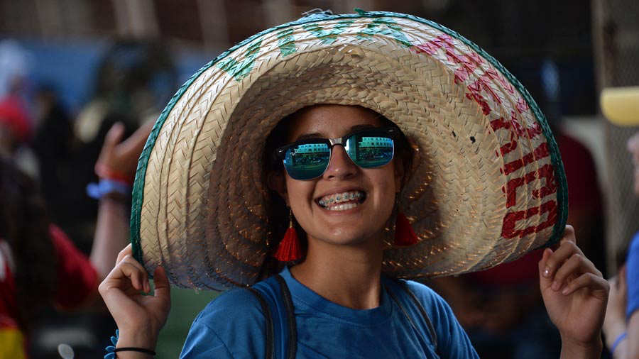 A pilgrim wearing a Mexican sombrero smiles for a photo in Panama Cit