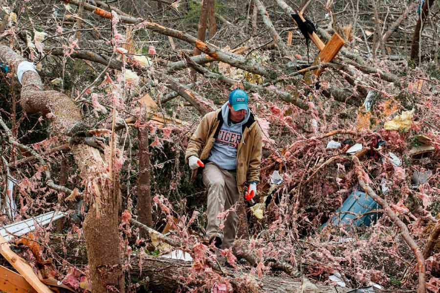 Joey Roush walks through debris March 4