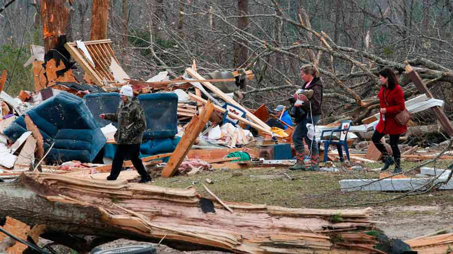 Residents look for belongings March 4