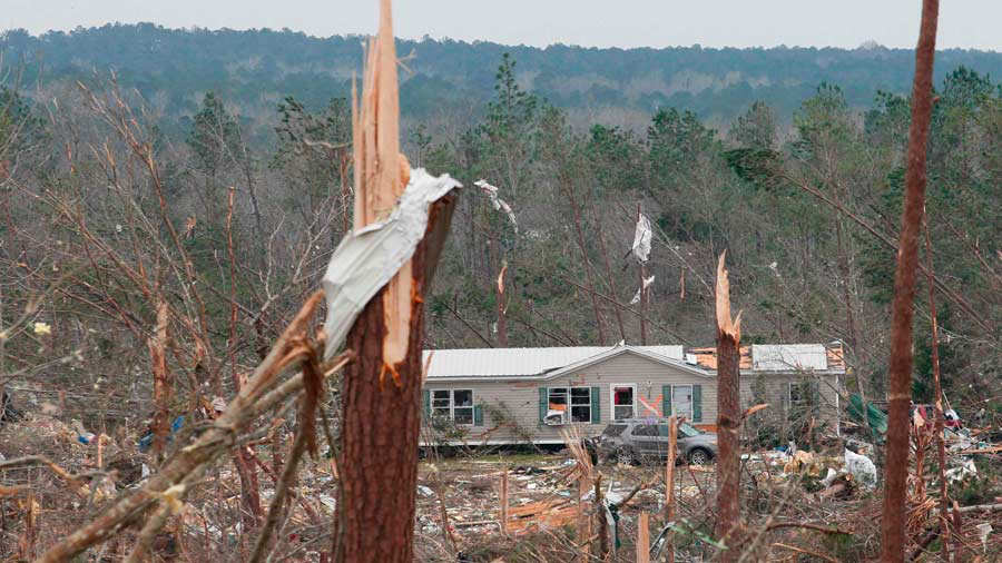 Damage is seen from a tornado which killed at least 23 people in Beau