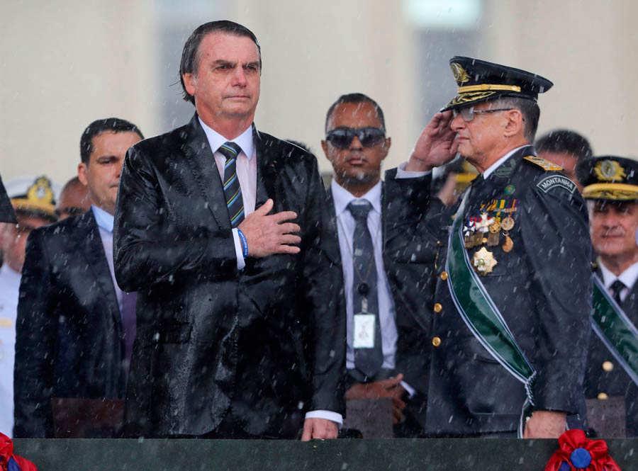 Brazilian President Jair Bolsonaro (C)