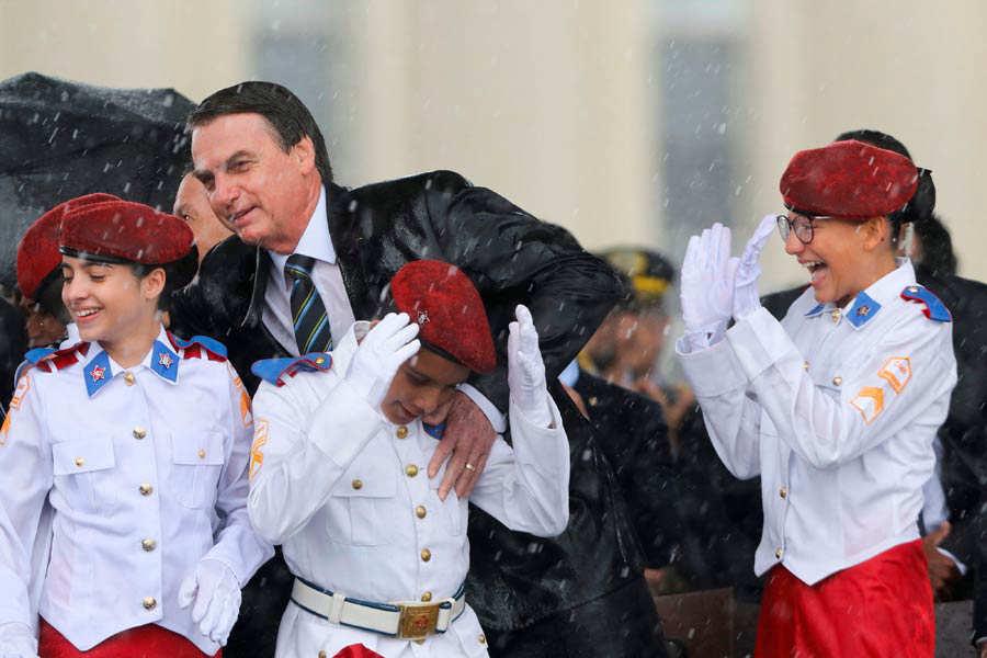 Brazilian President Jair Bolsonaro and students of the Military Colle