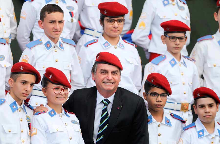 Brazilian President Jair Bolsonaro poses with students of the Militar