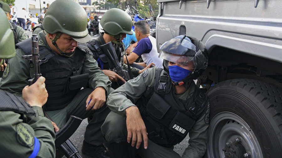 Soldiers supporting Venezuelan opposition leader and self-proclaimed