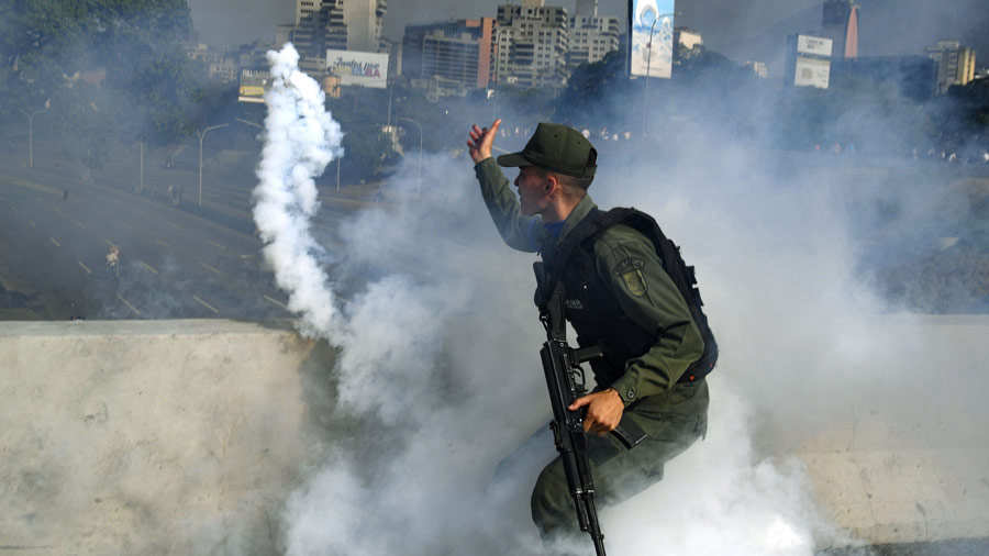 TOPSHOT - A member of the Bolivarian National Guard supporting Venezu