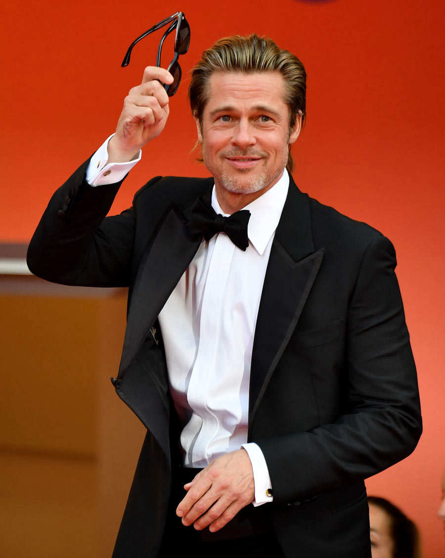 US actor Brad Pitt greets the crowd as he arrives for the screening o