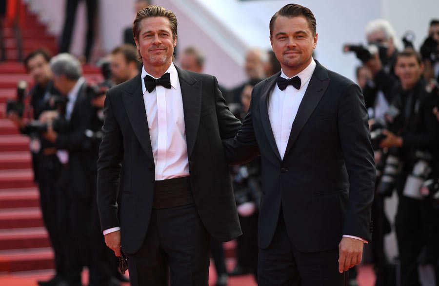 US actor Brad Pitt (L) and US actor Leonardo DiCaprio pose as they ar