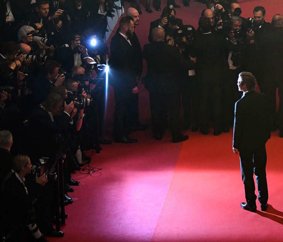 US actor Brad Pitt (C)