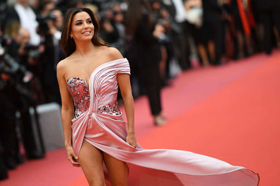 TOPSHOT - US actress Eva Longoria poses as she arrives for the screen