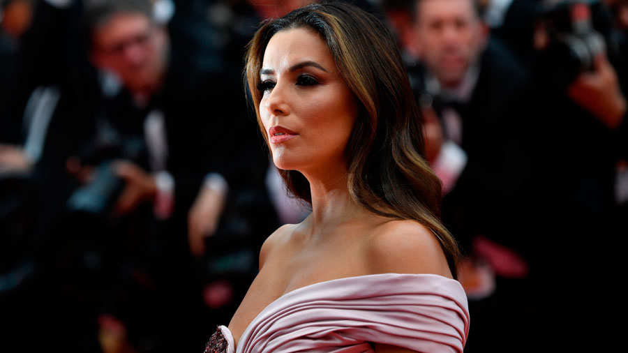 US actress Eva Longoria poses as she arrives for the screening of the