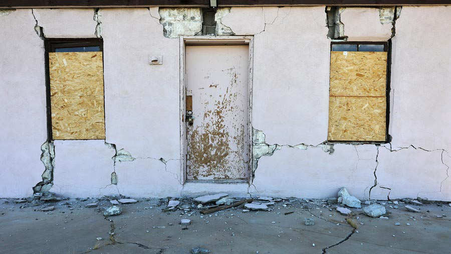 A house is seen damaged from a powerful earthquake that struck Southern California, near the epicenter