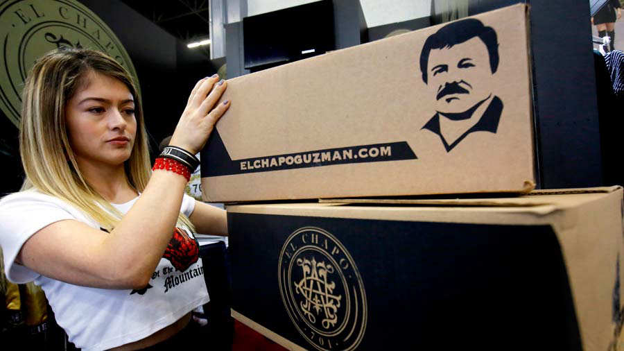 A woman places boxes containing clothing by