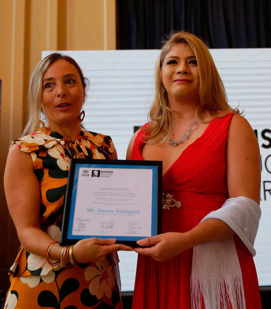 Salvadoran transgender Bianka Rodriguez (R) receives the United Natio