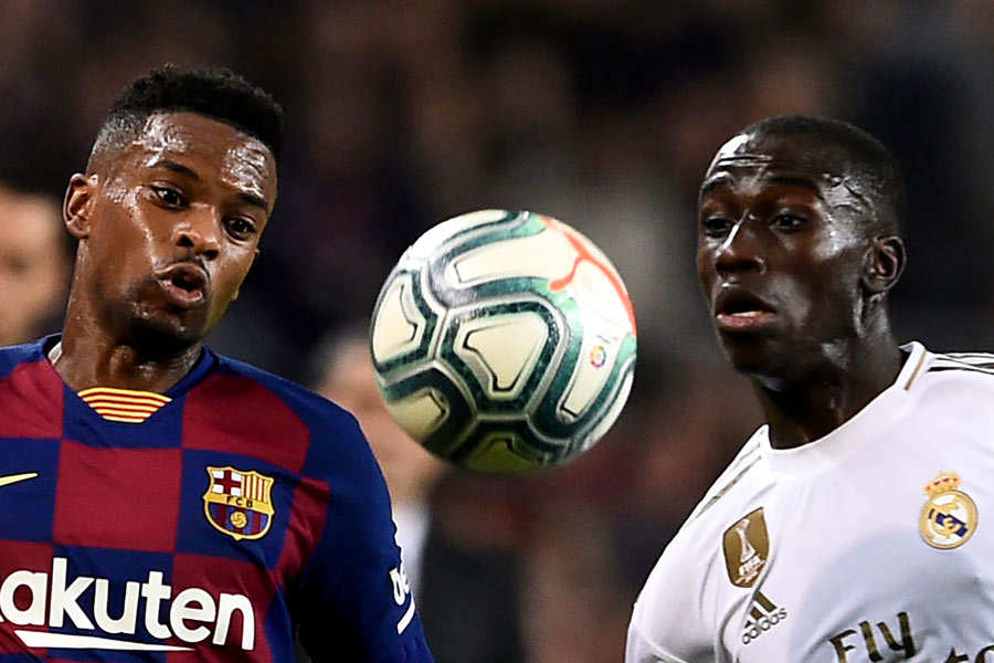 Barcelona's Portuguese defender Nelson Semedo (L) vies with Real Madr
