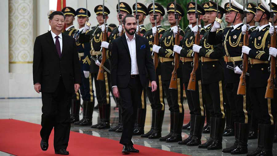 El Salvador's President Nayib Bukele (C) walks with China's President