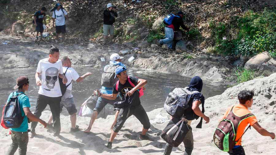 A Central American migrant - part of a caravan of mostly Hondurans tr