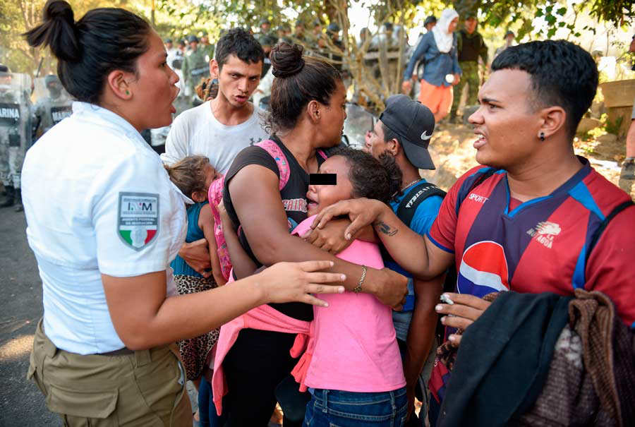 A Central American migrant family - heading in a caravan to the US -