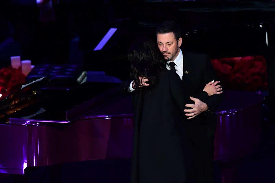 Kobe Bryant's wife Vanessa Bryant (L) hugs US television host Jimmy K