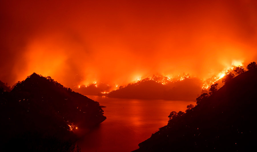 TOPSHOT - Flames surround Lake Berryessa during the LNU Lightning Com