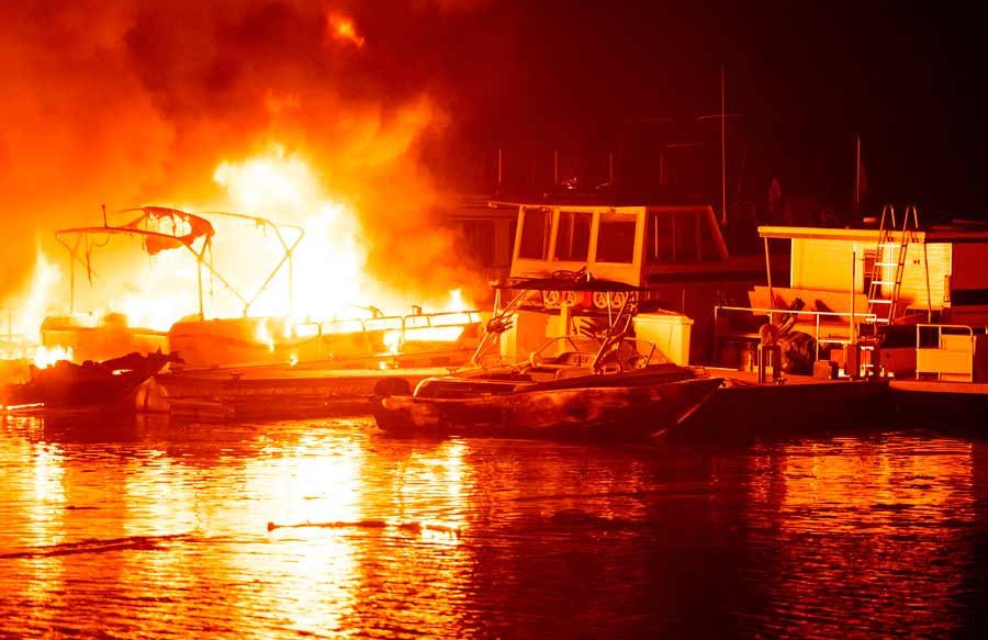 Docked boats burn on Lake Berryessa during the LNU Lightning Complex