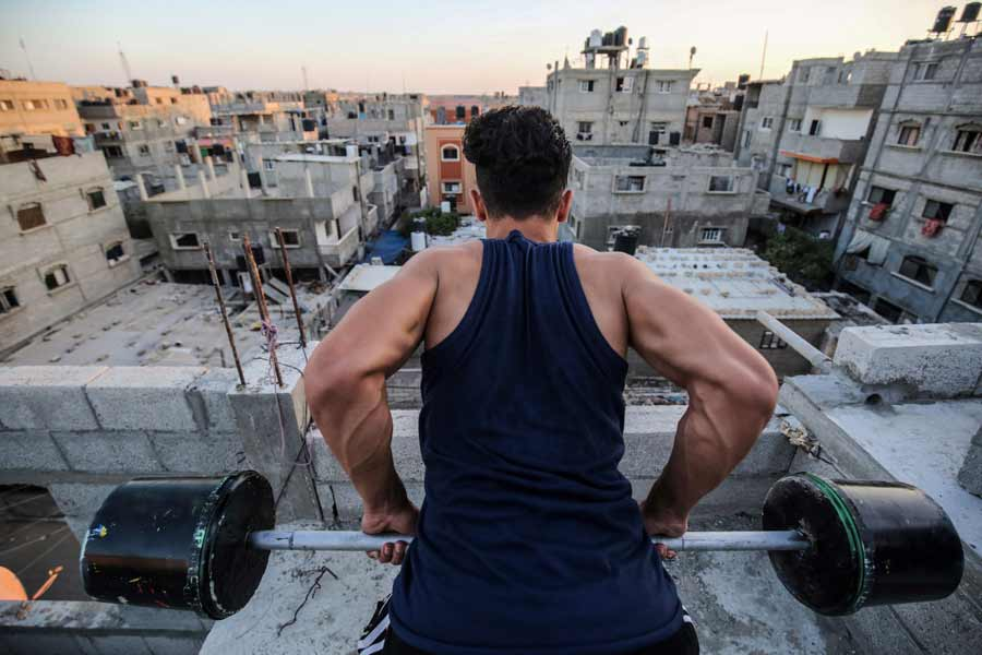 A Palestinian body builder uses construction equipment to train in th