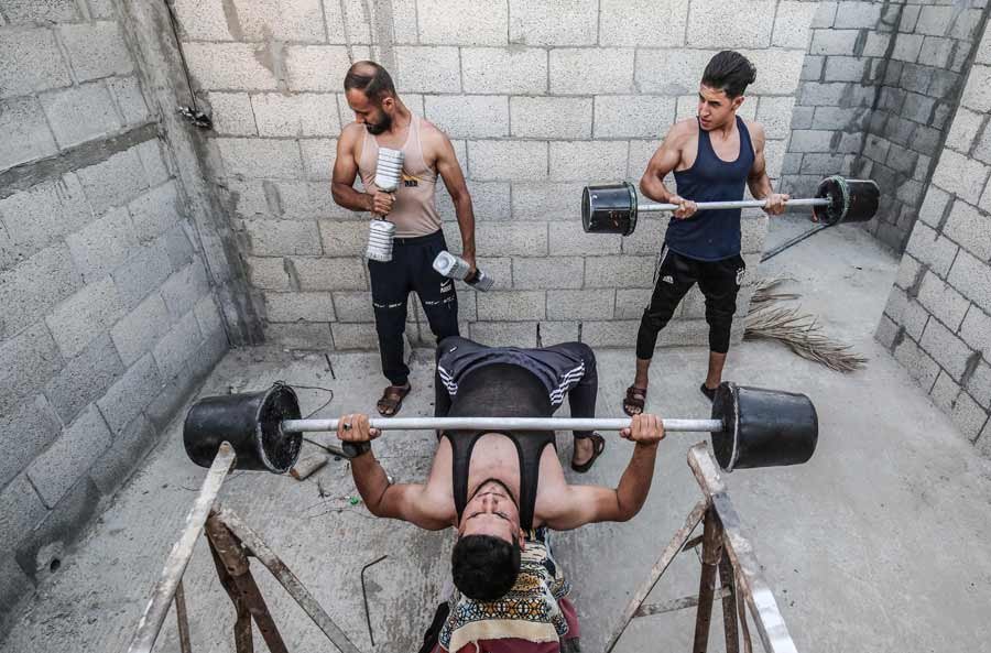 Palestinian body builders use construction equipment to train in the